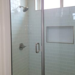 Blue tiled shower with glass doors - J&J Quality Construction