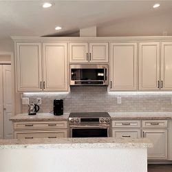 White cabinetry and granite countertops in a Fresno kitchen renovation