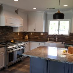 Custom kitchen design featuring white custom cabinets for a Fresno kitchen remodeling
