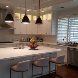 Kitchen renovation with white custom cabinetry and stainless stell appliances