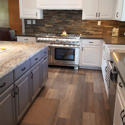 Custom hardwood flooring and cabinetry for a Clovis kitchen remodeling
