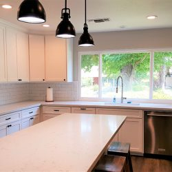 Fresno kitchen renovation with custom white cabinets and sliding barn door pantry