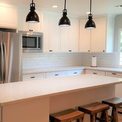 Clovis kitchen remodeling with white custom cabinetry and stainless steel appliances