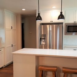 Fresno kitchen remodeling with white custom cabinets and stainless steel appliances