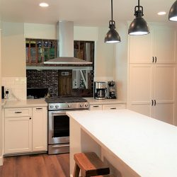 Clovis kitchen renovation with white custom cabinetry and unique hanging lamps