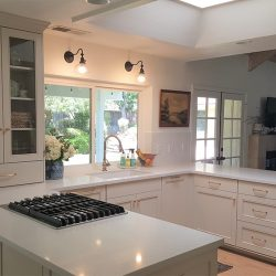 High end kitchen renovation with white countertops and white cabinetry
