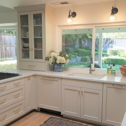 Kitchen remodeling with white cabinetry and white granite counter tops