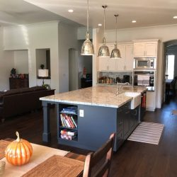 White kitchen features with dark grey kitchen island in Clovis