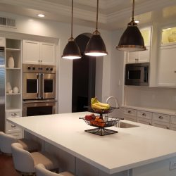Kitchen remodeling with white custom cabinets and kitchen island