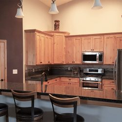 Kitchen design with custom cabinets and dark countertops