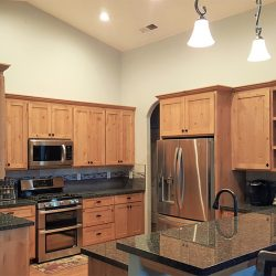 Custom Clovis kitchen design with dark countertops and custom cabinets