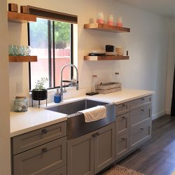 Light grey cabinetry with white kitchen countertops in Clovis