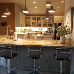 Grey barstools around custom countertops and custom cabinets in Fresno