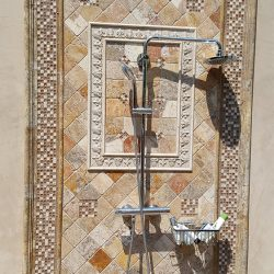 Outdoor shower with metal features from an outdoor renovation
