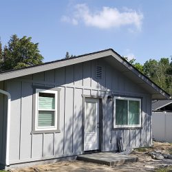 Room addition for a light grey home in Fresno
