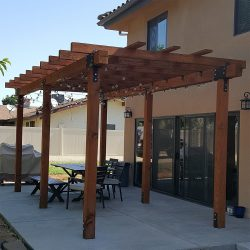 Custom wood patio cover for a backyard