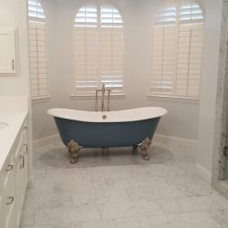 Blue clawfoot bathtub with white interior, wide shot - J&J Quality Construction