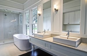 White bathroom with marble counters and vessel sinks - J&J Quality Construction
