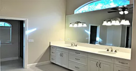 White bathroom with double vanity and sinks