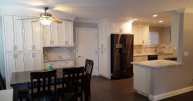 Kitchen and dining area with white cabinets