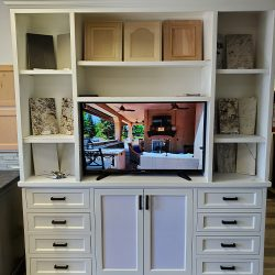 White entertainment center in our Fresno cabinet showroom