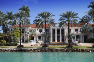 home in Florida with palm trees on open water