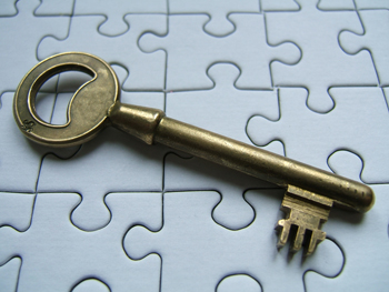 bigstock-puzzle-and-key-16320834