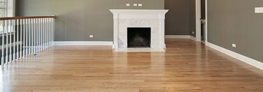 Open up your space with a refinished hardwood floor