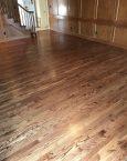 Image of brown hardwood flooring in an empty area