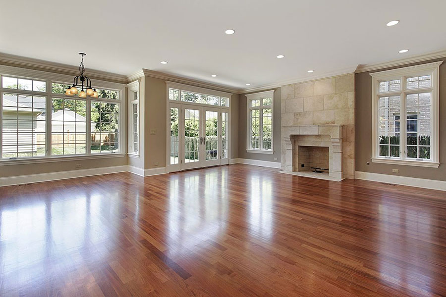 Image of empty room with shining wood flooring