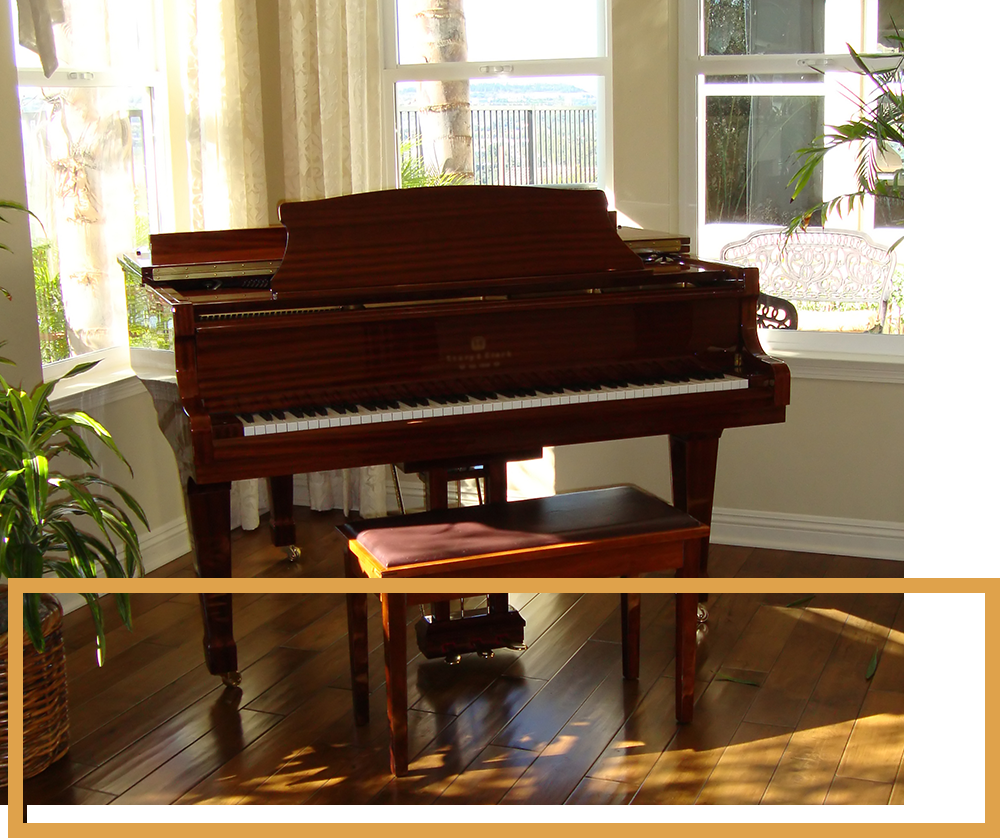 Image of a room with a piano and a nice wooden floor