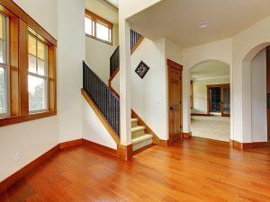 Empty living room with beautiful refinished hardwood floor.