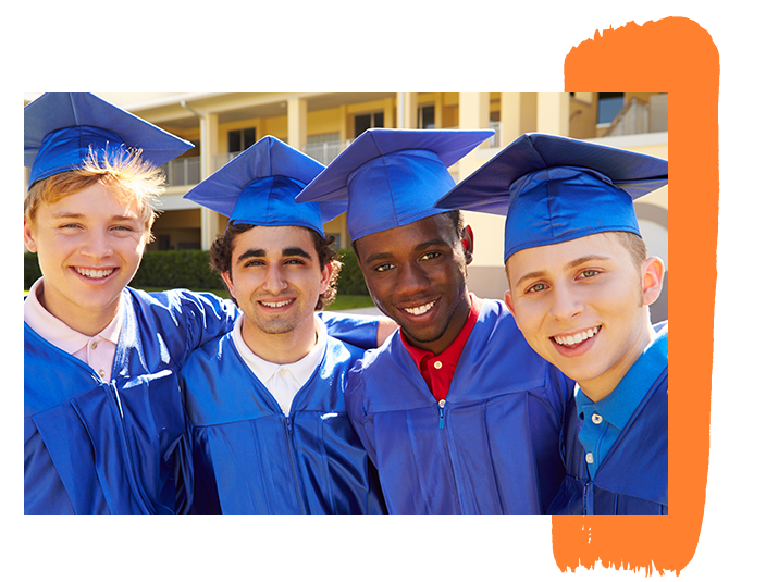 An image of four boys at graduation in blue caps and gowns