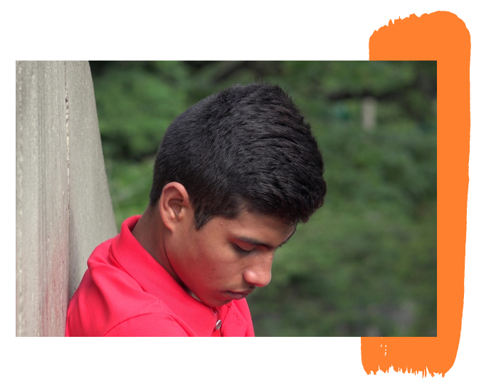 latin-teen-leaning-against-a-wall-with-his-head-down-mobile-6138d735e26df
