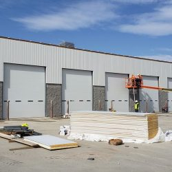 Commercial Building With Overhead Doors Under Construction