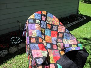 Batik Squares with Piano Key Border Draped