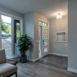 Home renovation entryway with a door with windows and wood floors - Kay2 Contracting