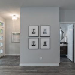 Home renovation featuring an art wall, wood floors, and main bathroom - Kay2 Contracting