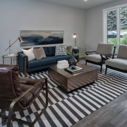 Modern living room renovation with wood floors and large windows - Kay2 Contracting