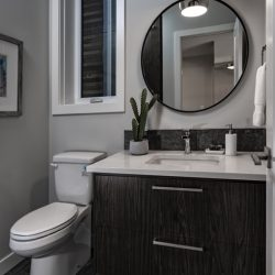 Main bathroom renovation with dark cabinets and white countertop - Kay2 Contracting