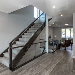 Home renovation with wood floors and stairs with glass railing - Kay2 Contracting
