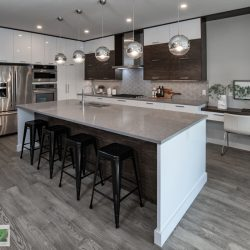 Kitchen renovation with gray-brown floors, gray countertop, and white cabinets - Kay2 Contracting