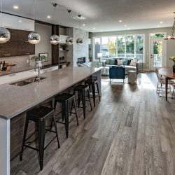 Open concept kitchen and living room after home renovation - Kay2 Contracting