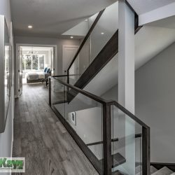 Interior of a home with stairs, hallway, and view of bedroom - Kay2 Contracting