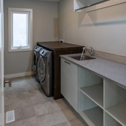 Laundry room renovation with open cabinets and sink - Kay2 Contracting