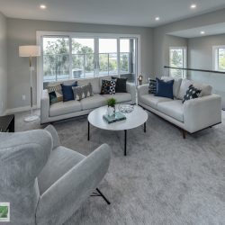 Completed home renovation living room with sofas and carpet - Kay2 Contracting