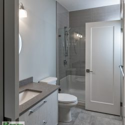 Master bathroom renovation with tile floors, glass shower, and gray cabinets - Kay2 Contracting