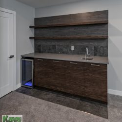 Wet bar area with wine cooler in a finished basement renovation - Kay2 Contracting