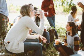 Friends gathering on lawn