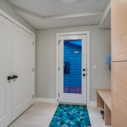 View of entryway with closets, glass door, and storage cabinets - Kay2 Contracting